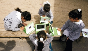 Young girls in Gaza learning how use computers.