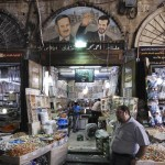 Syrian activists warn against taking up arms
