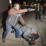 Undercover police officer pulls gun on Oakland protesters after cover blown