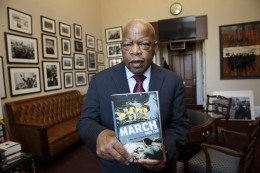 Congressman John Lewis holds a copy of March, Book 2, the second volume of his graphic memoir of his years as a civil rights activist. A comic book about Martin Luther King inspired him to join the movement.